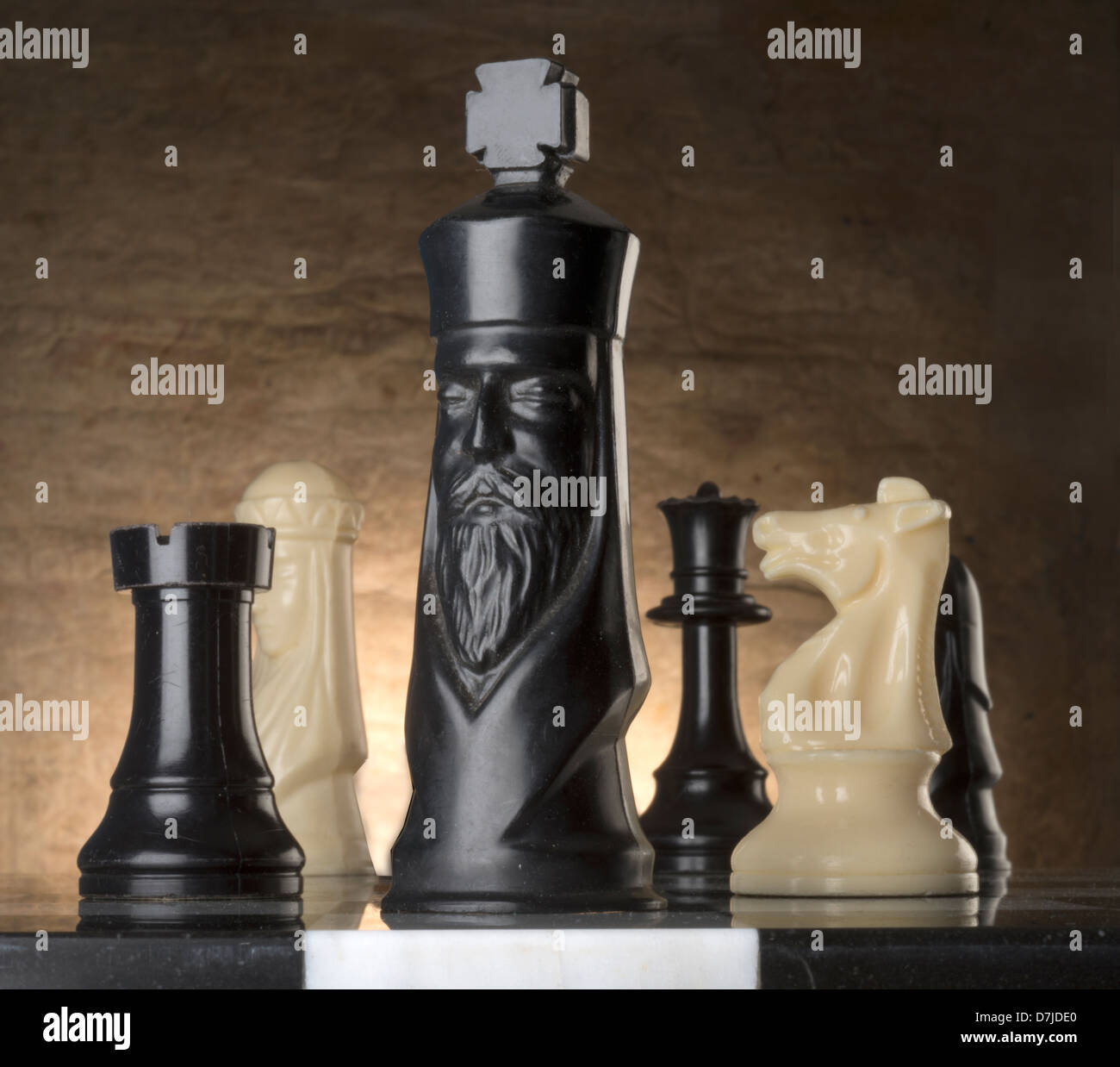 chess pieces on marble playing board - Stock Image