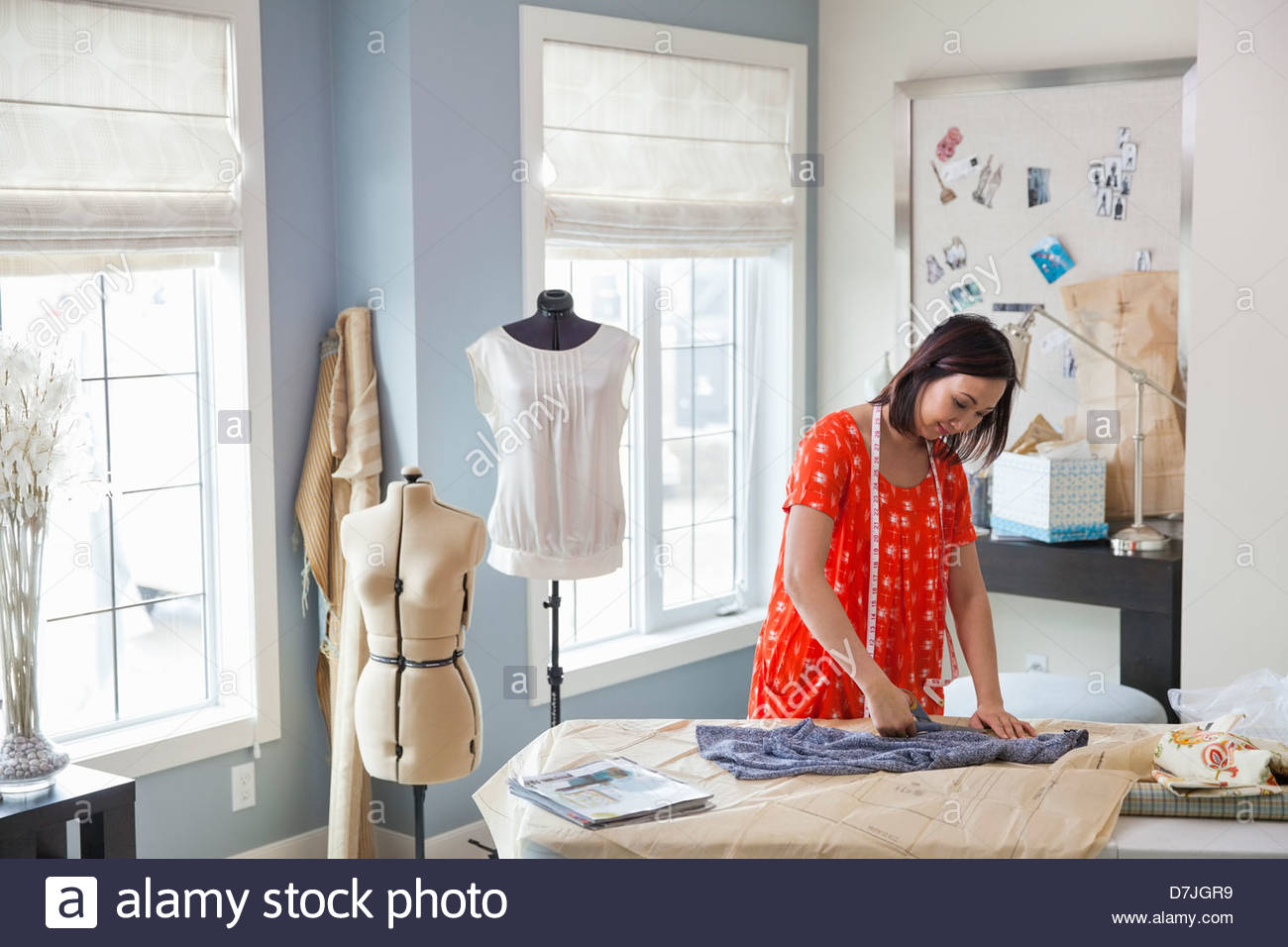 Female seamstress working in home studio Stock Photo: 56342029 - Alamy