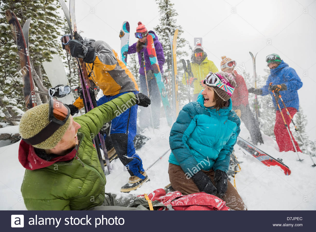 Group of backcountry skiers throwing snow - Stock Image