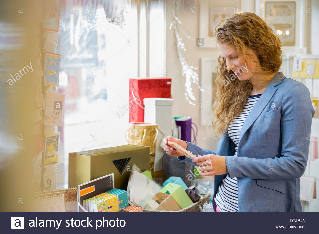 Young woman shopping at card store - Stock Image
