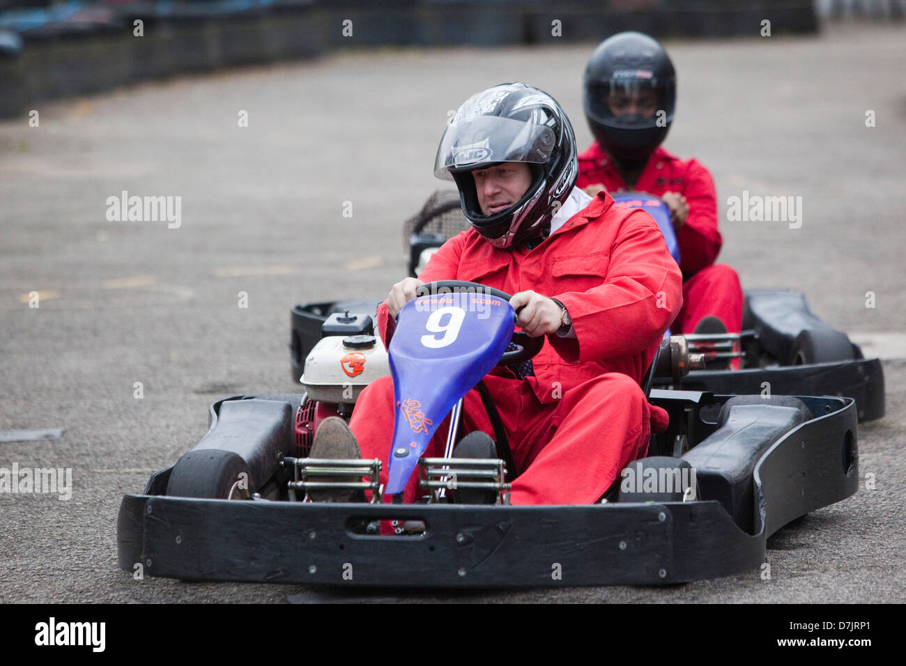 London Mayor Boris Johnson goes go-karting in a boiler suit in support of a charity - Stock Image