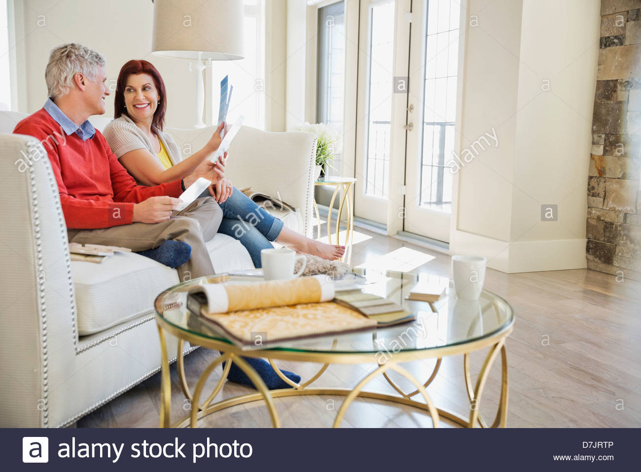 Mature couple choosing paint colors in new home Stock Photo ...