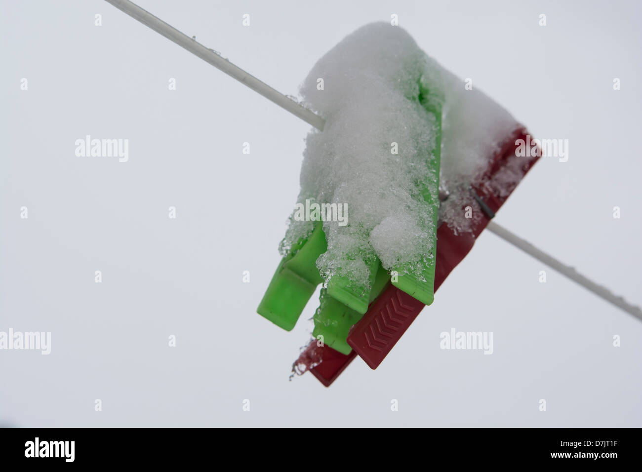 It is supposed to be Spring and the line full of drying clothes but the weather has other plans - Stock Image