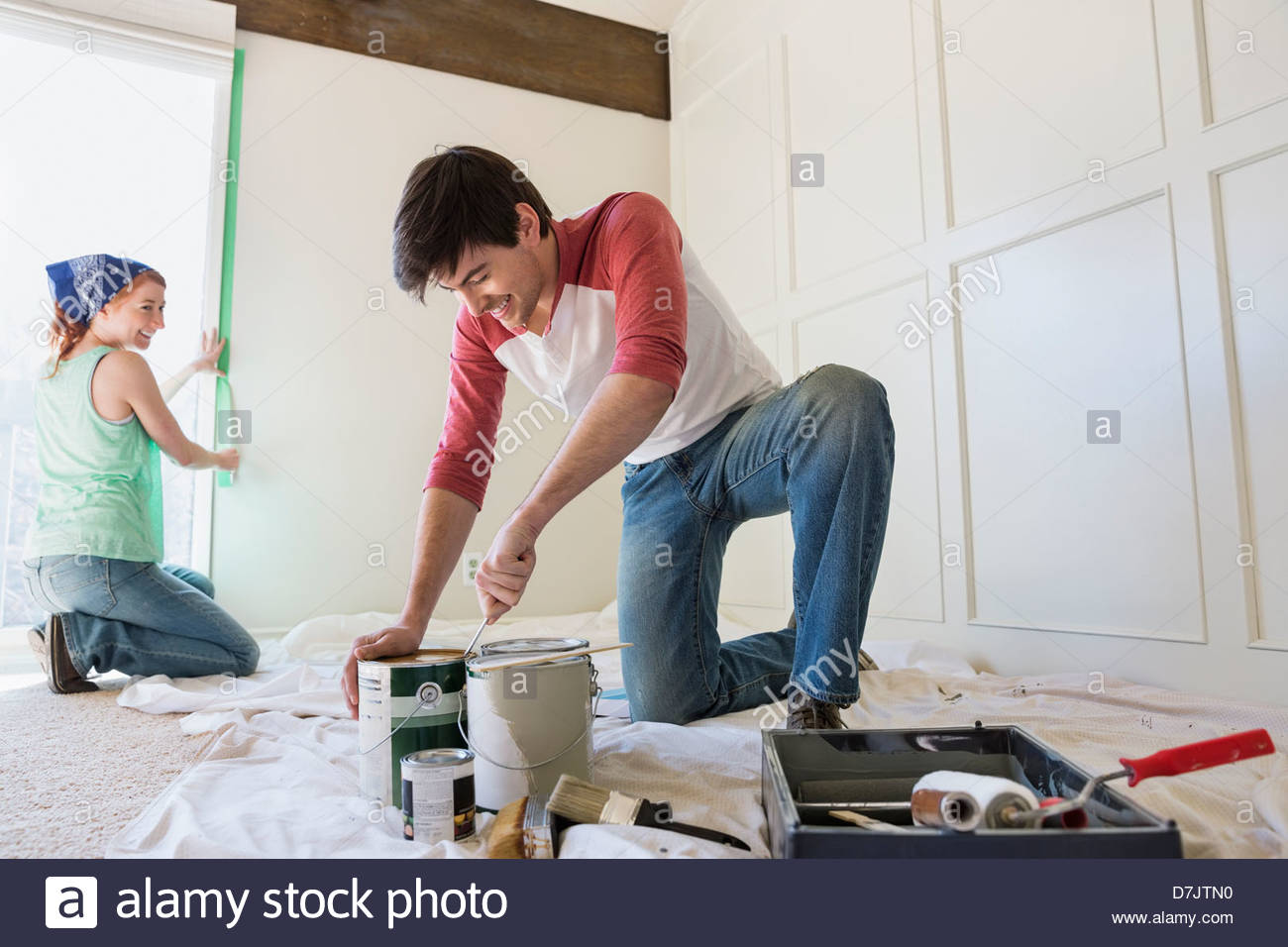 Young couple preparing to paint at home - Stock Image