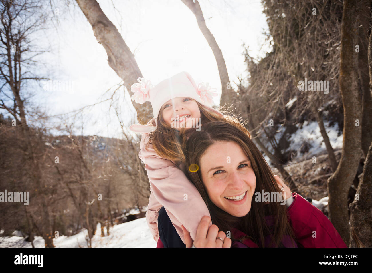 USA, Utah, Highland, Young woman carrying her daughter (2-3) on shoulders - Stock Image