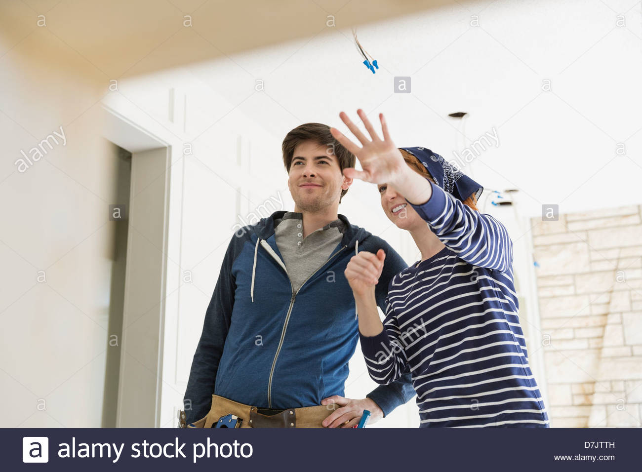 Young couple discussing renovations at home - Stock Image