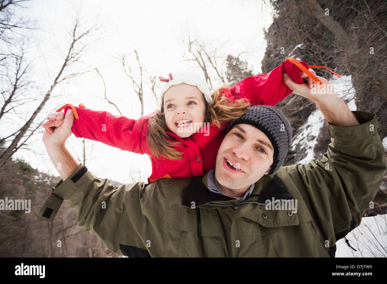 USA, Utah, Highland, Portrait of young man carrying girl (2-3) on shoulders - Stock Image