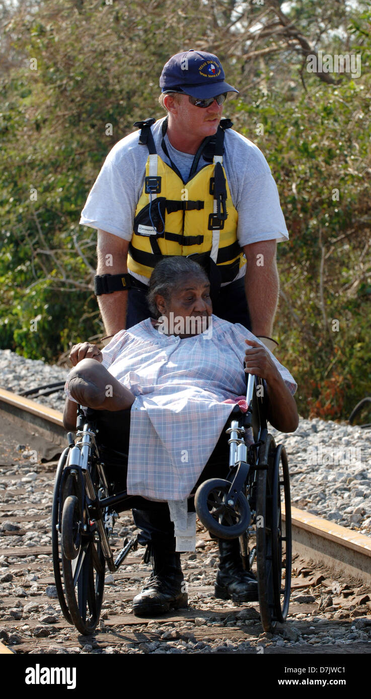 A survivor is rescued by urban search and is wheeled to a staging point in the aftermath of Hurricane Katrina August Stock Photo
