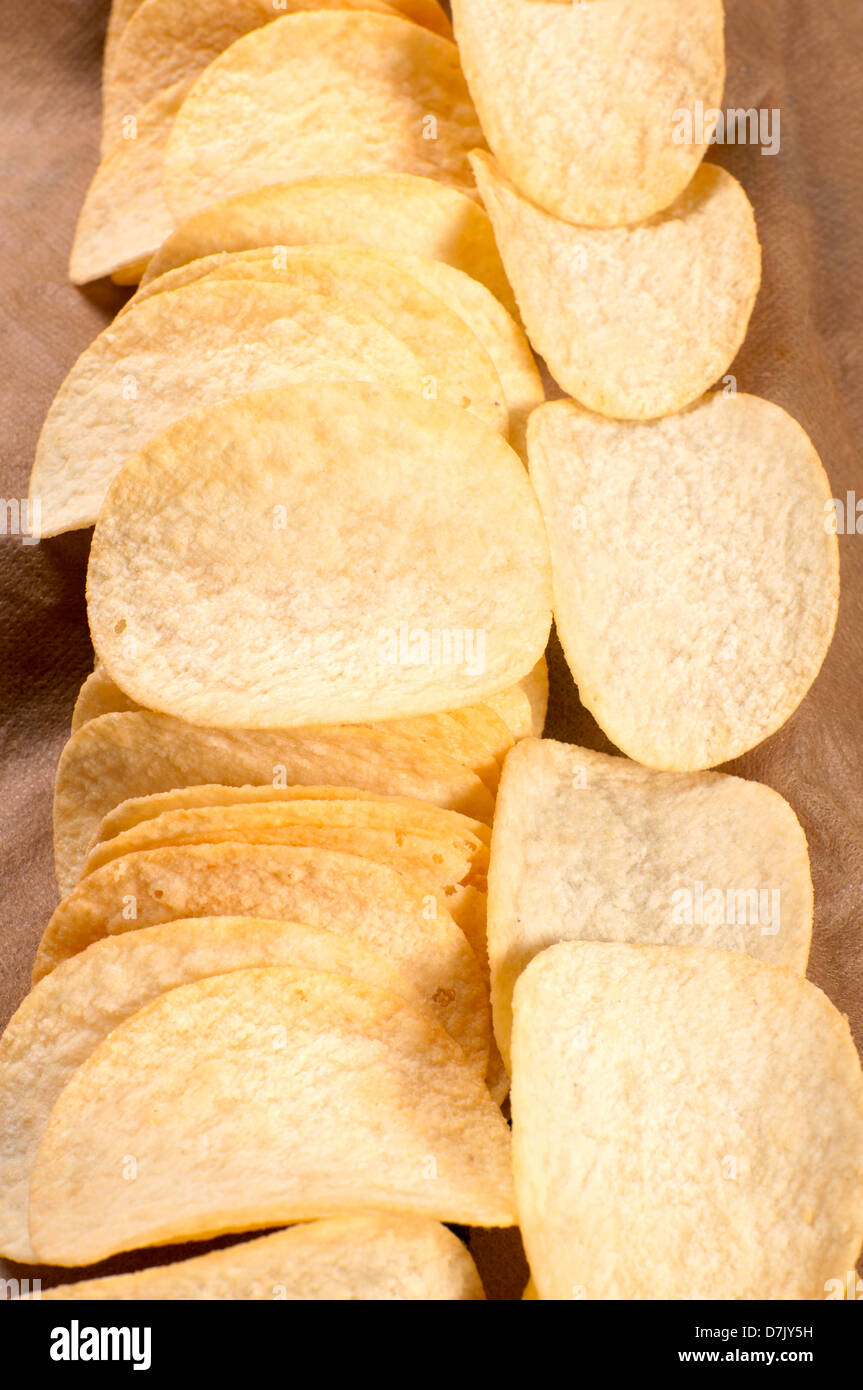 Homemade potato chips from above - Stock Image