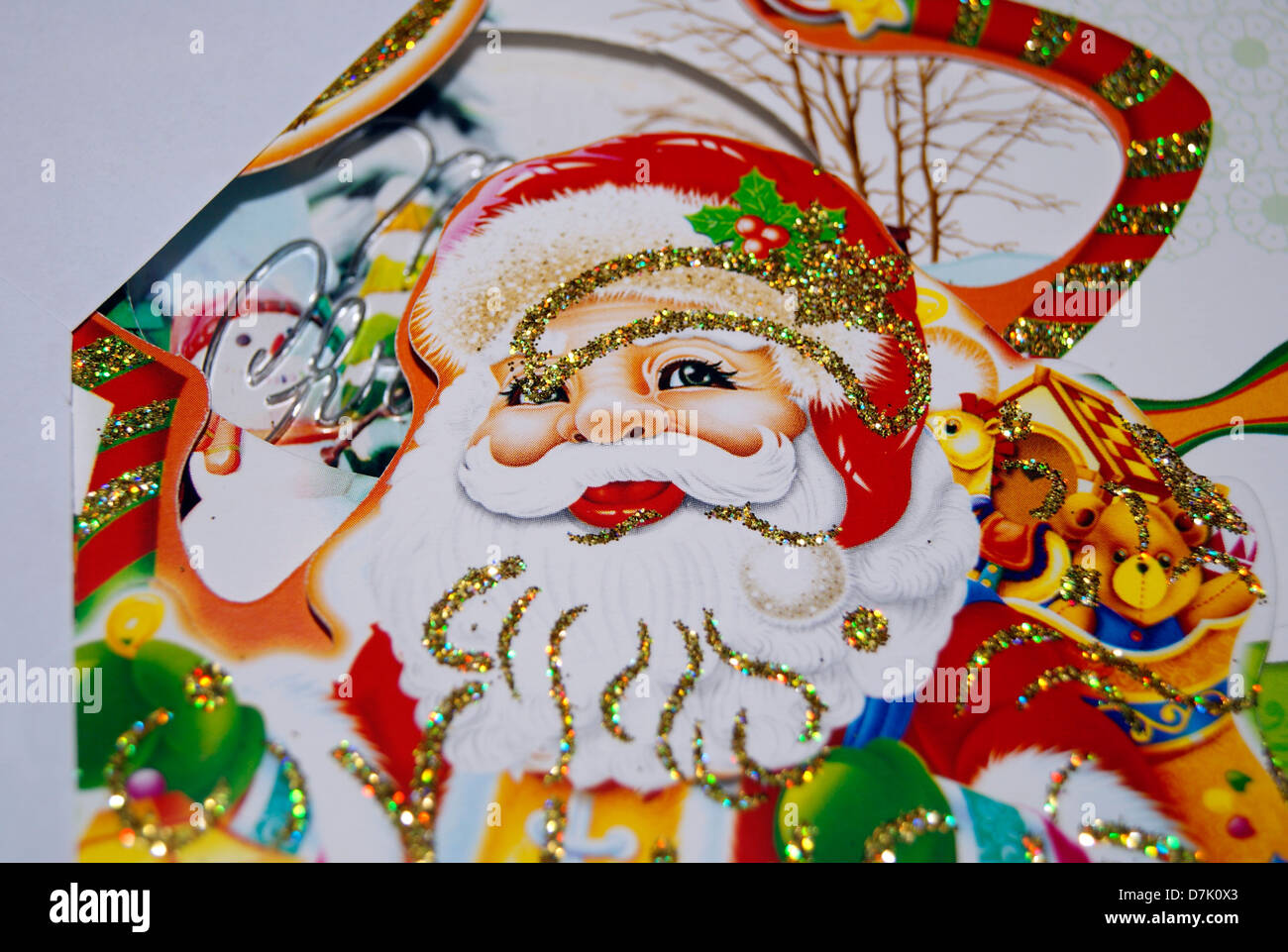 Santa Claus Smiling face on Christmas Greeting card - Stock Image