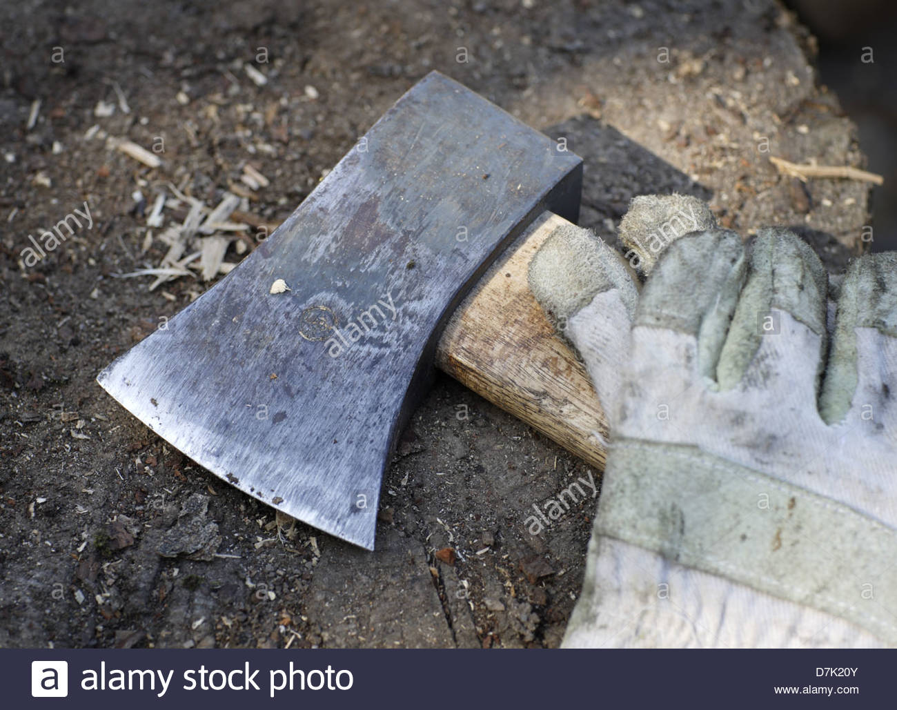 Close-up of an axe with a pair of gloves - Stock Image