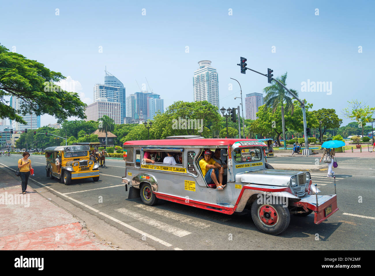 jeepneys in rizal park of manila philippines - Stock Image