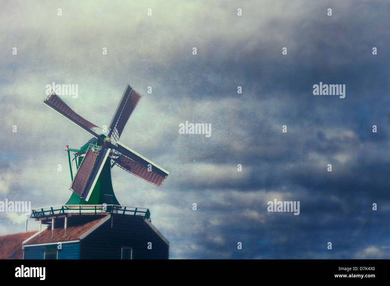 a windmill in front of stormy sky - Stock Image