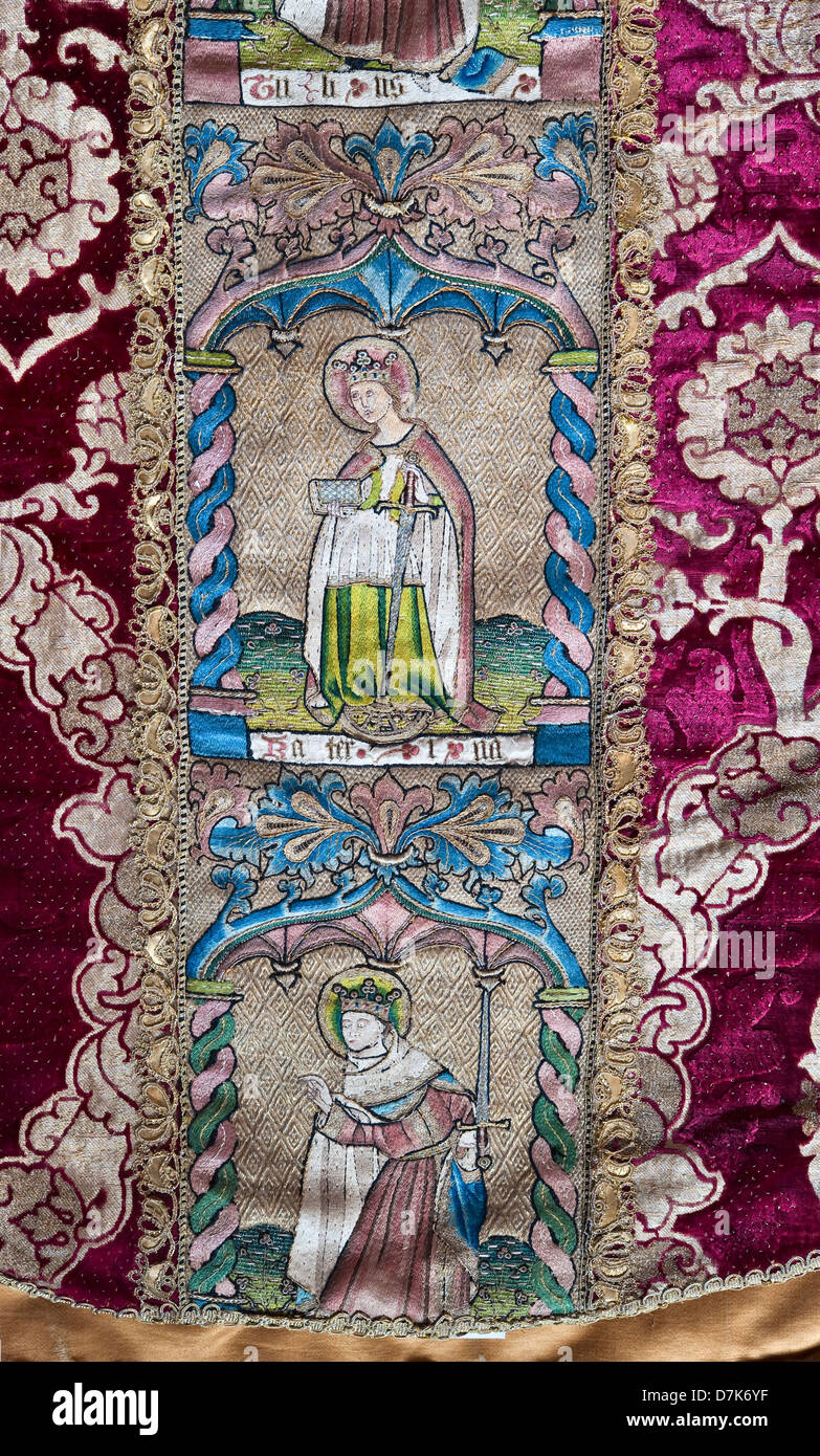 A detail of a finely embroidered medieval cope, to be worn by a Catholic priest - Stock Image