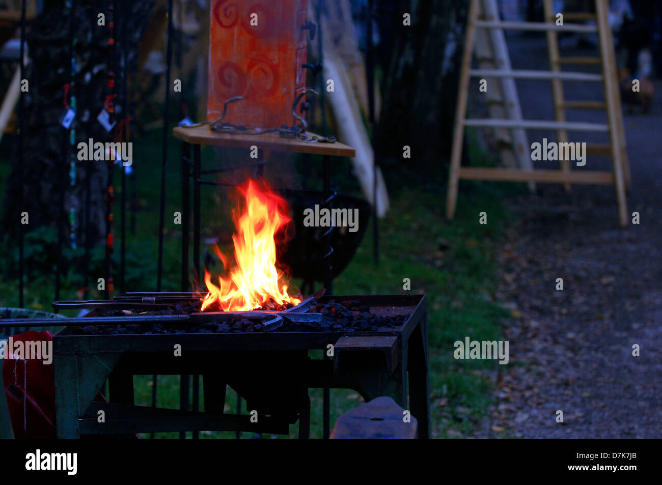 Blacksmith, forge, Stoke, forging, fireplace, embers glow - Stock Image