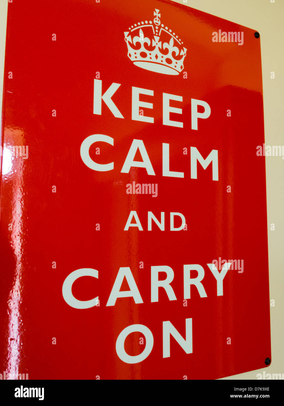 World War two propaganda poster Keep Calm and Carry On in red and white nailed to wall Derbyshire England - Stock Image