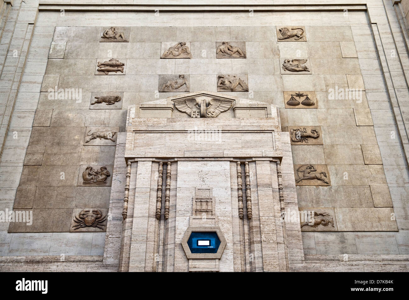 Milan railway station (Milano Centrale), Italy, completed in 1931. The signs of the Zodiac - Stock Image