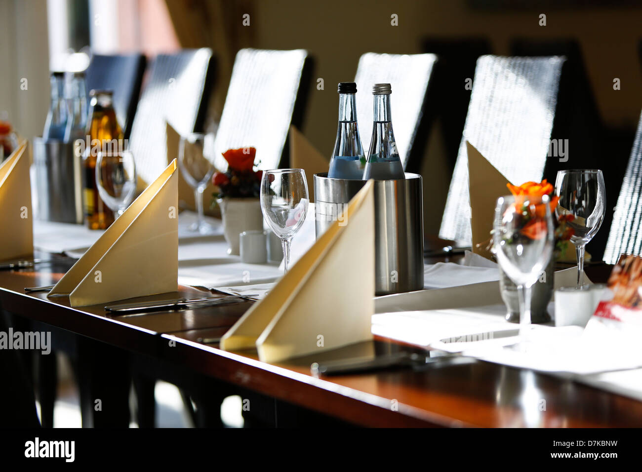 Germany, Baden Wuerttemberg, Heidelberg, Table laid with wine bottles and glasses - Stock Image
