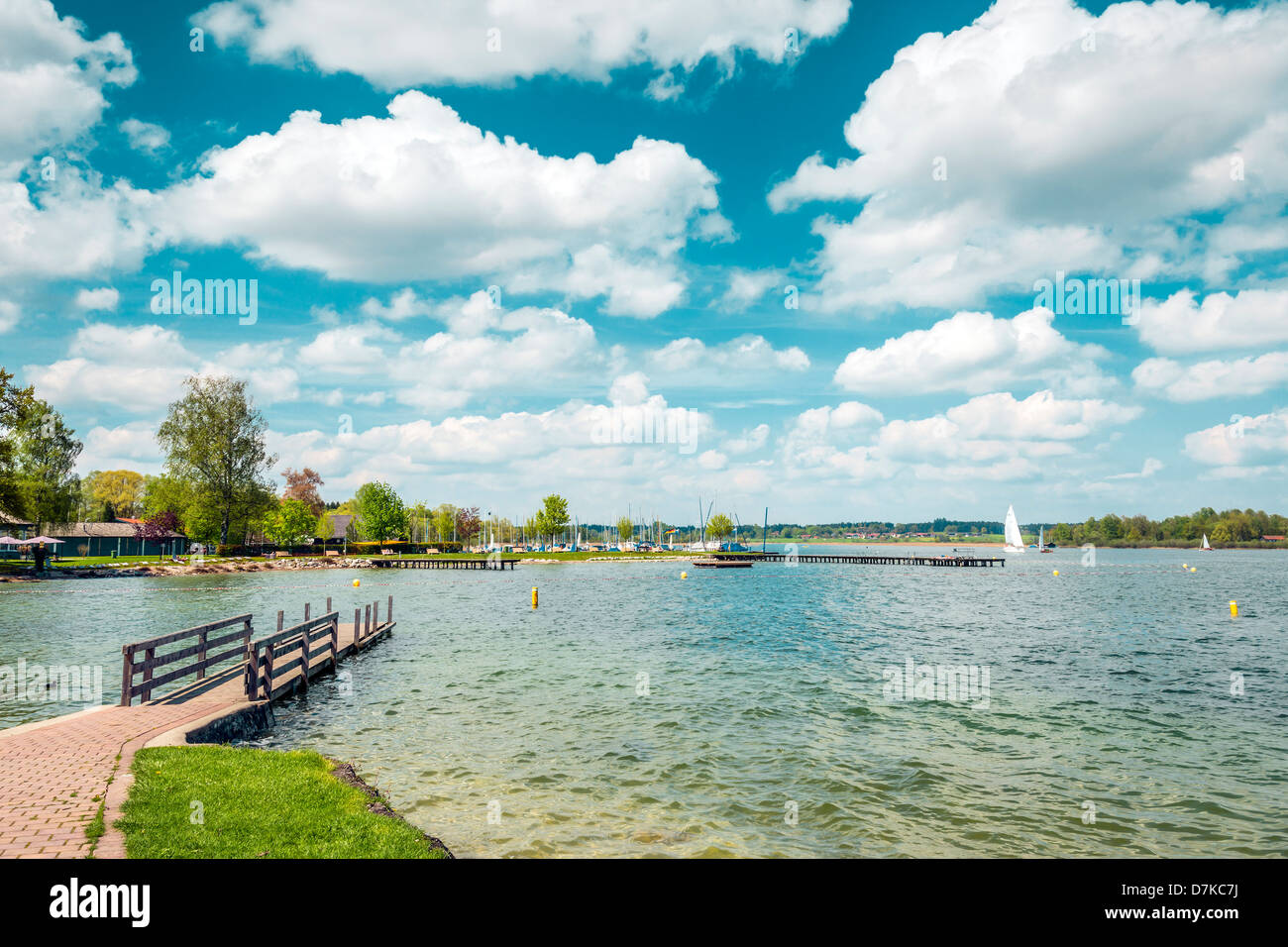 Lake Chiemsee in Germany with sailboat and bright sun. Stock Photo