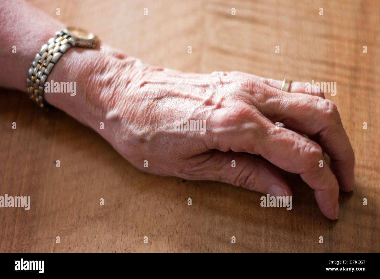 Germany, Hesse, Frankfurt, Human hand on table - Stock Image