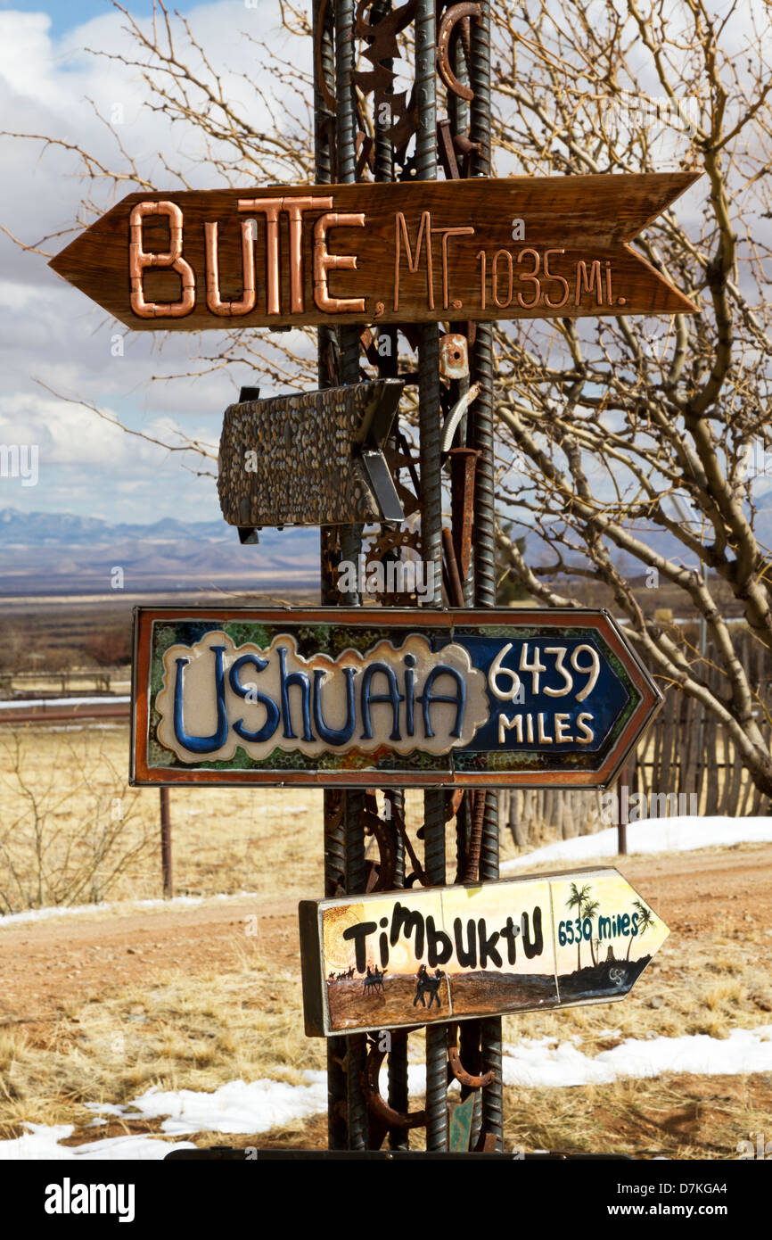 Directional signs point to distant places; location is Dragoon Mountains in Arizona, south of Tucson. - Stock Image