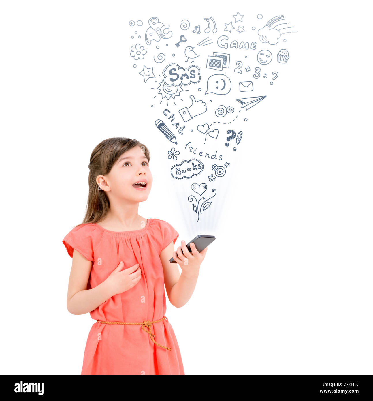 Happy cute little girl in red dress holding a smartphone in hand and fascinated looking up at the icons of different - Stock Image