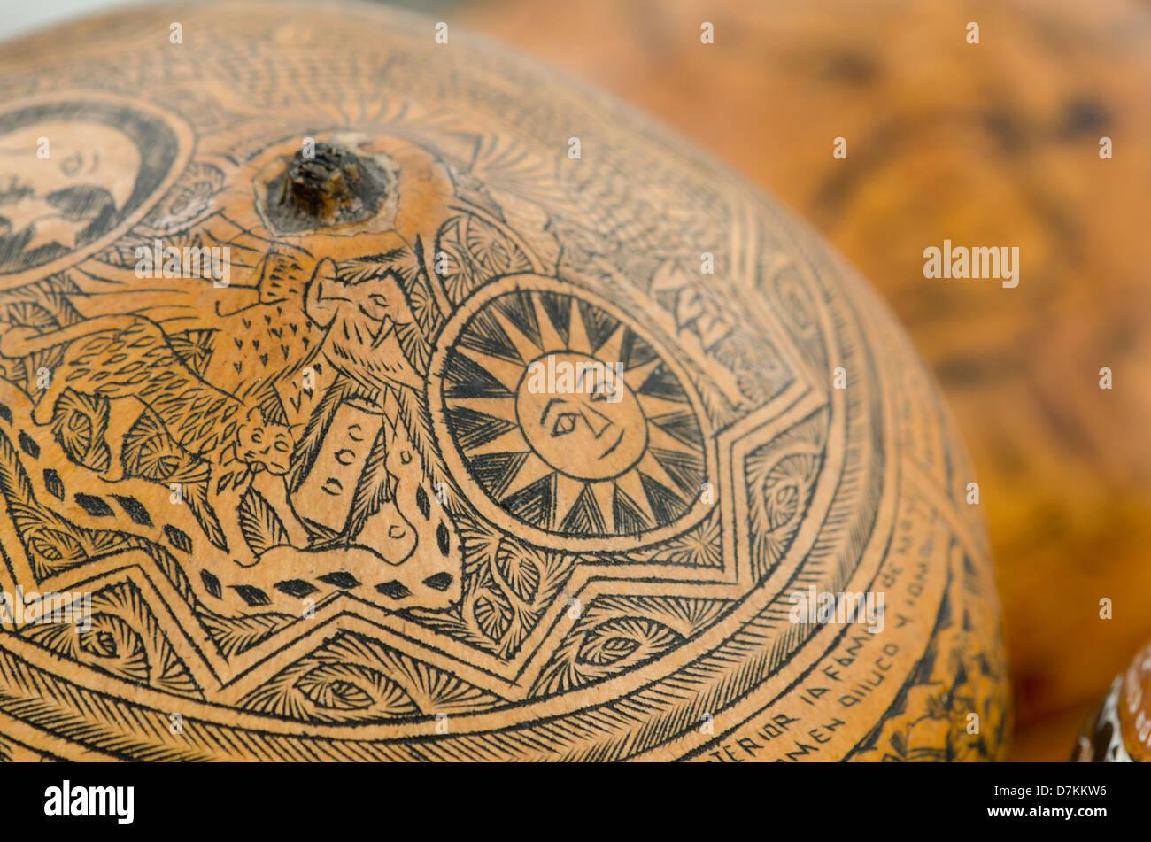 Ecuador, Quito area. Otavalo Handicraft Market. Hand carved dried gourds. - Stock Image