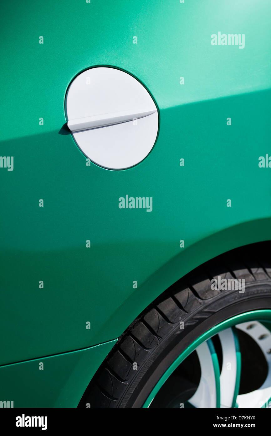 car fuel tank lid white green closeup - Stock Image