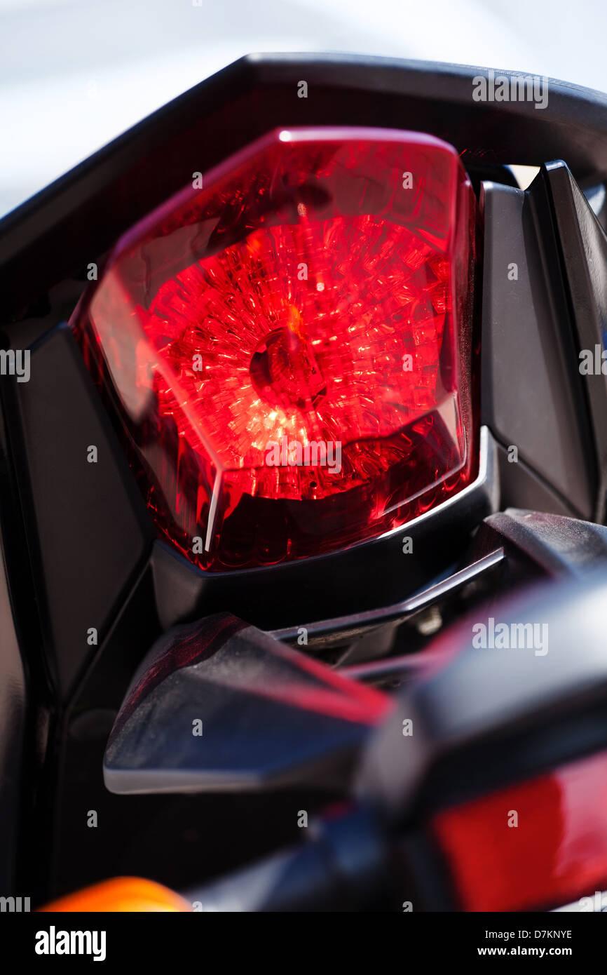 motorcycle rear stop light closeup - Stock Image