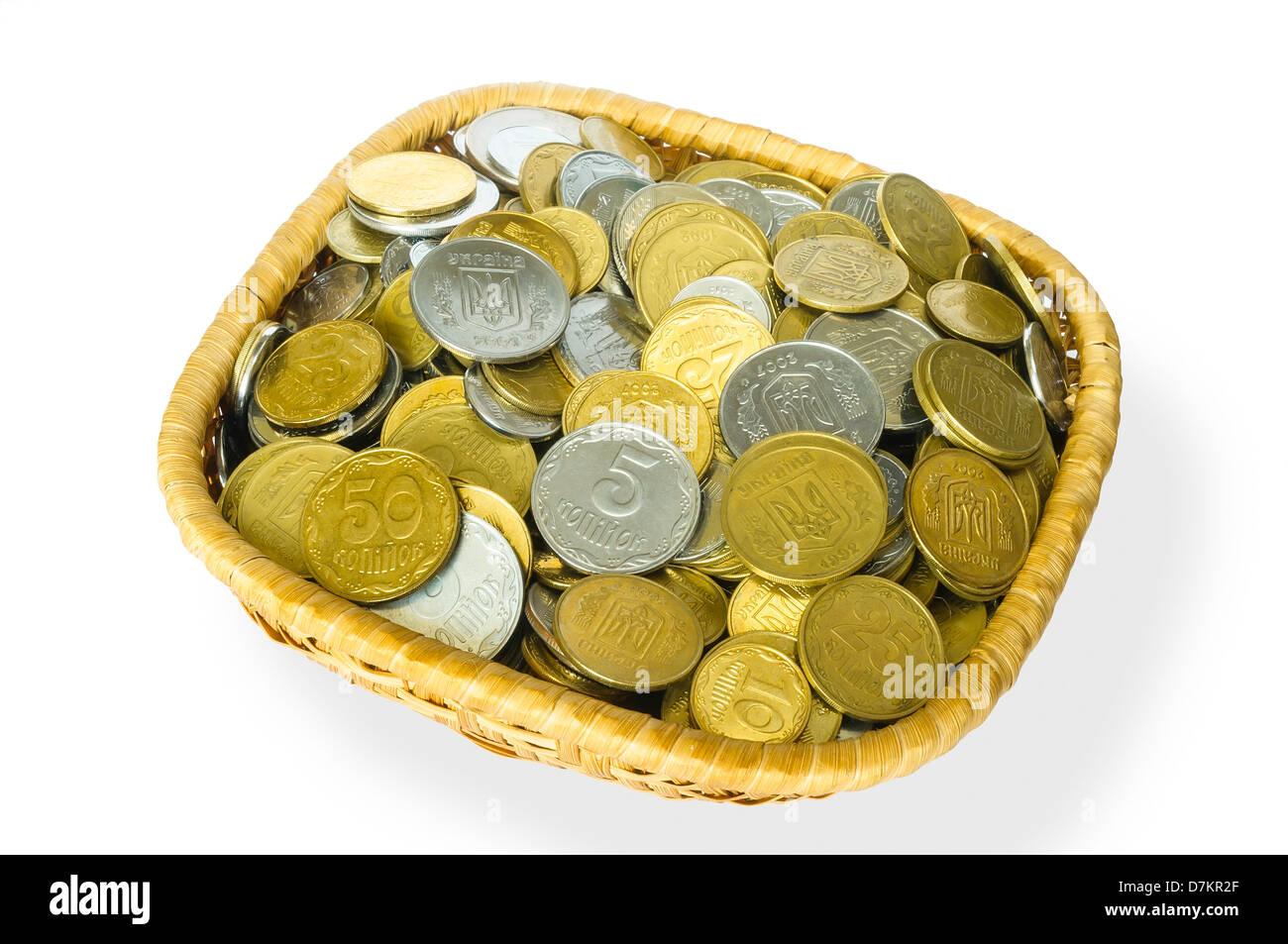 Many ukrainian kopek in a little basket - Stock Image