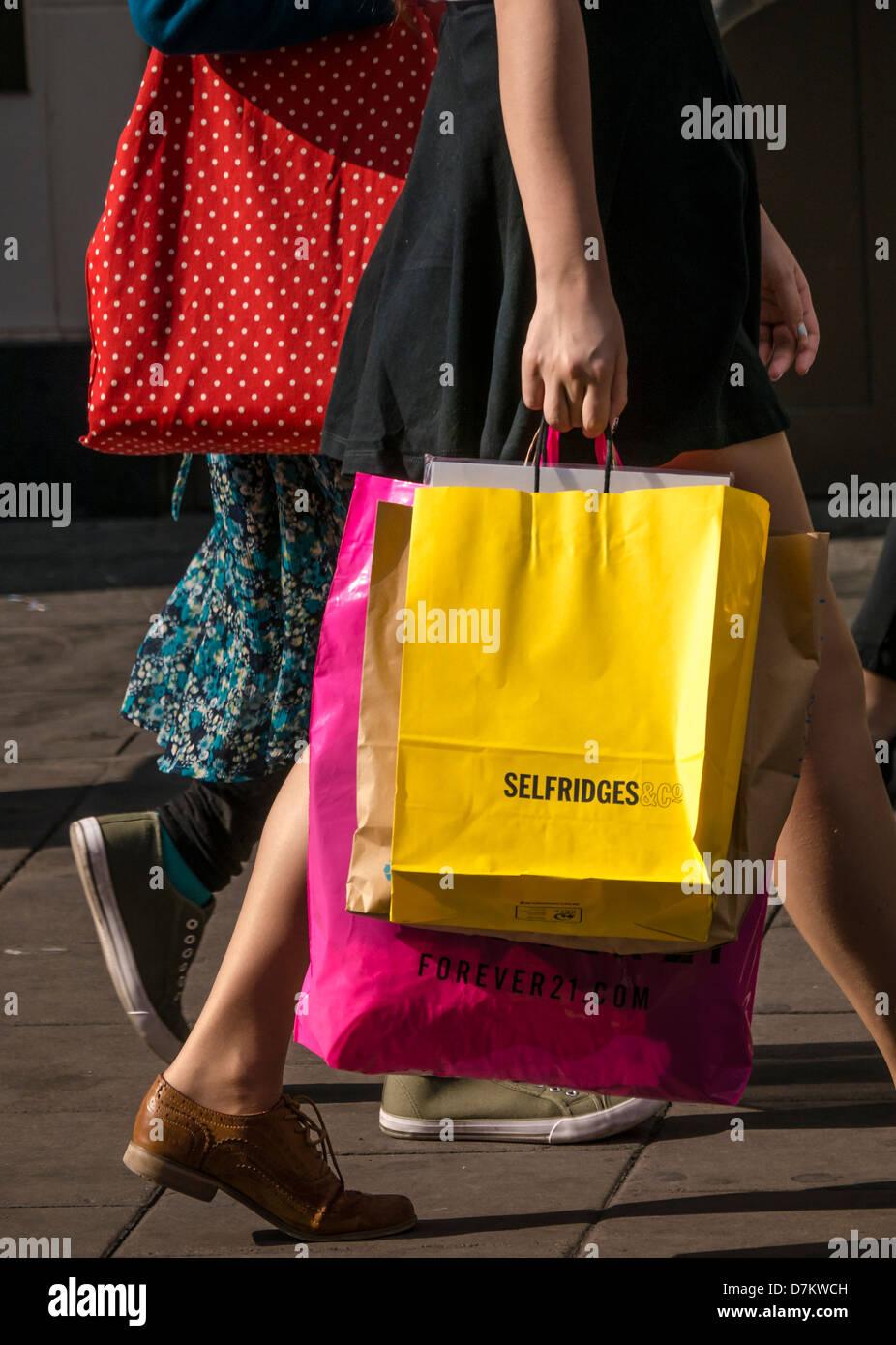 Woman holding Selfridges Shopping bag - Stock Image