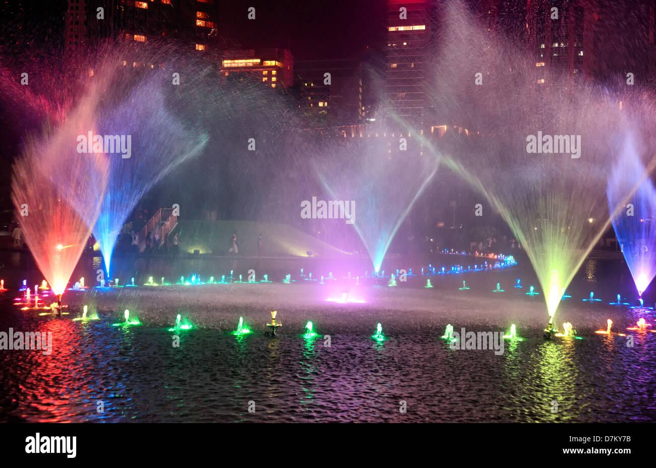 bright colourful water fountains in kuala lumpur malaysia - Stock Image