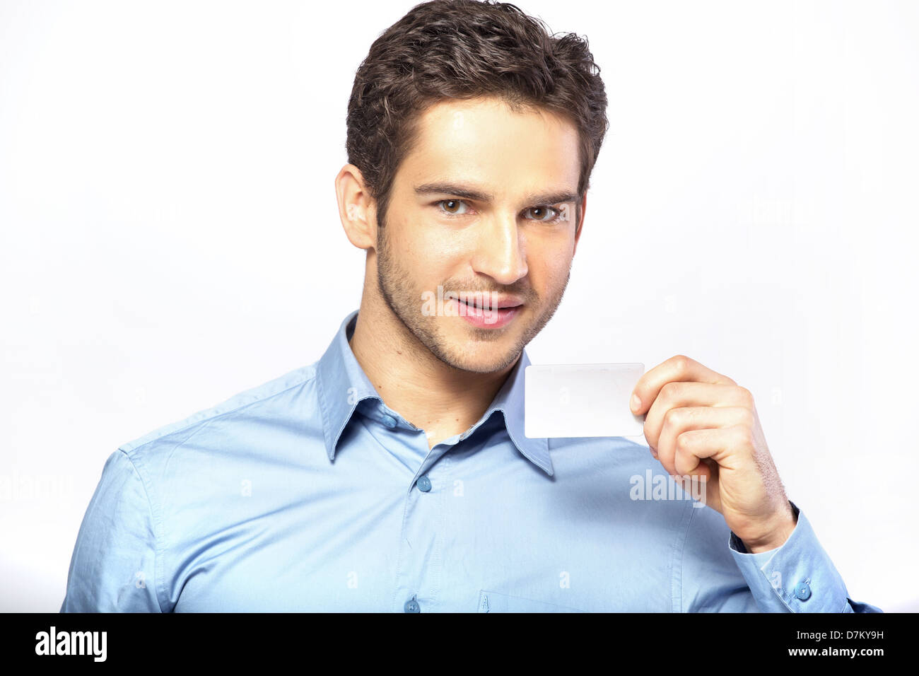Good-looking guy holding business card Stock Photo: 56372221 - Alamy