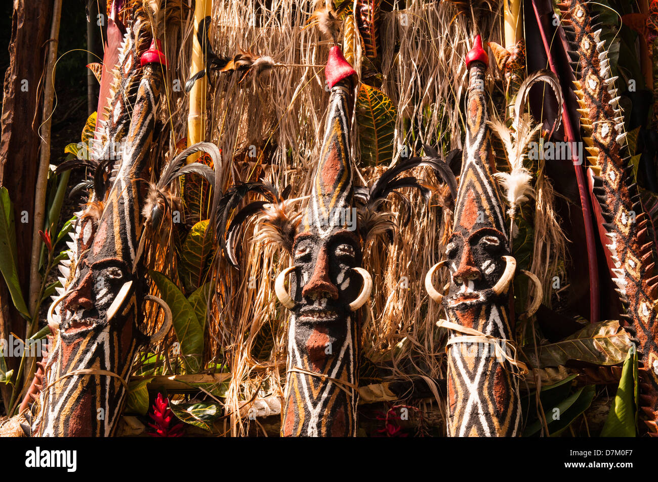 Carved wooden figures decorate the outside of a wooden tower built for the Ordination ceremony of a village chief - Stock Image