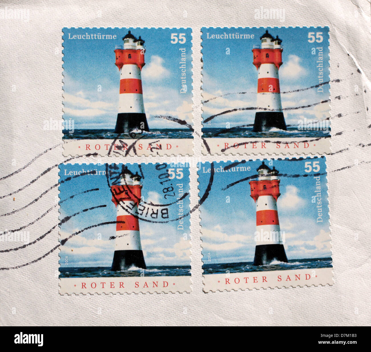 Four used postage stamps lighthouse from Germany - Stock Image
