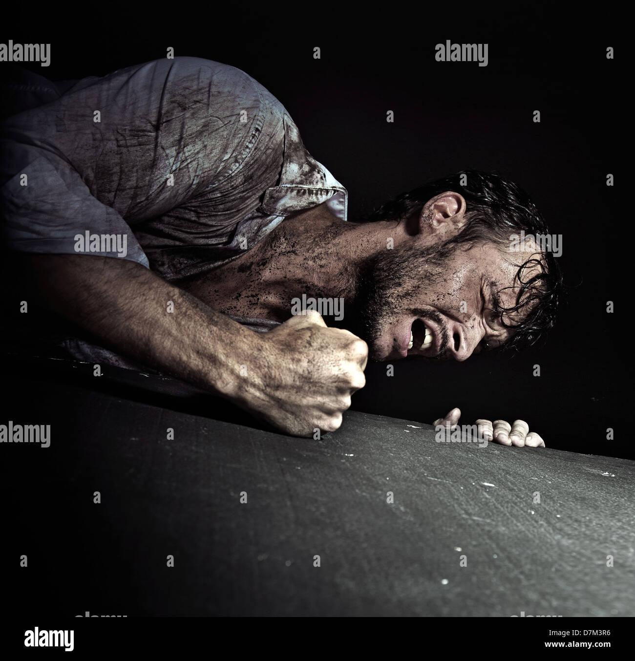 Resigned handsome guy hitting the floor - Stock Image
