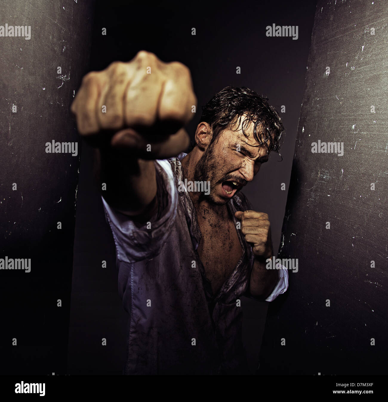Fighting filthy guy with tough nature - Stock Image