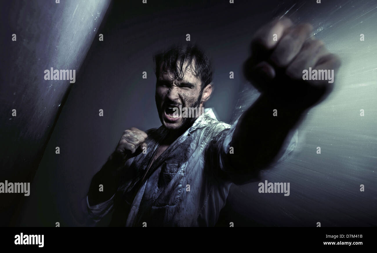 Dirty handsome guy fighting for egsistance - Stock Image