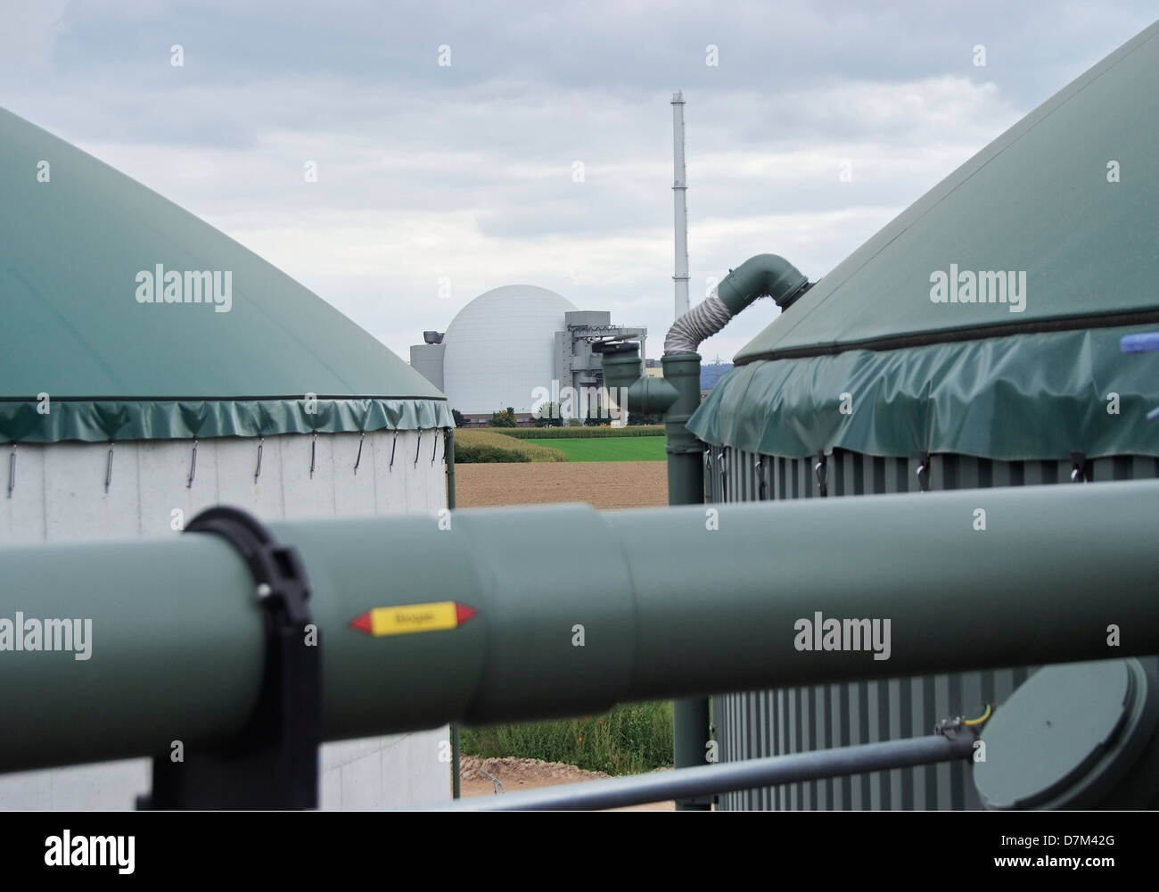 Germany, Biogas plant and nuclear power plant - Stock Image