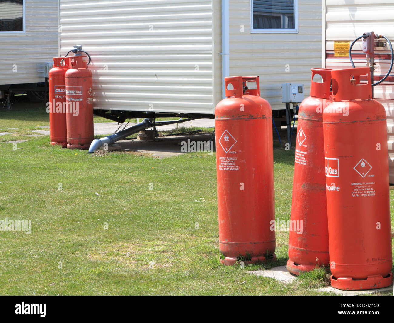 Propane gas cylinders on a caravan site - Stock Image