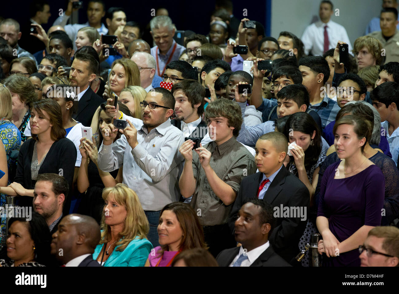 Audience members listen as U.S. President Barack Obama speaks at Manor New Technology High School in Manor, Texas - Stock Image