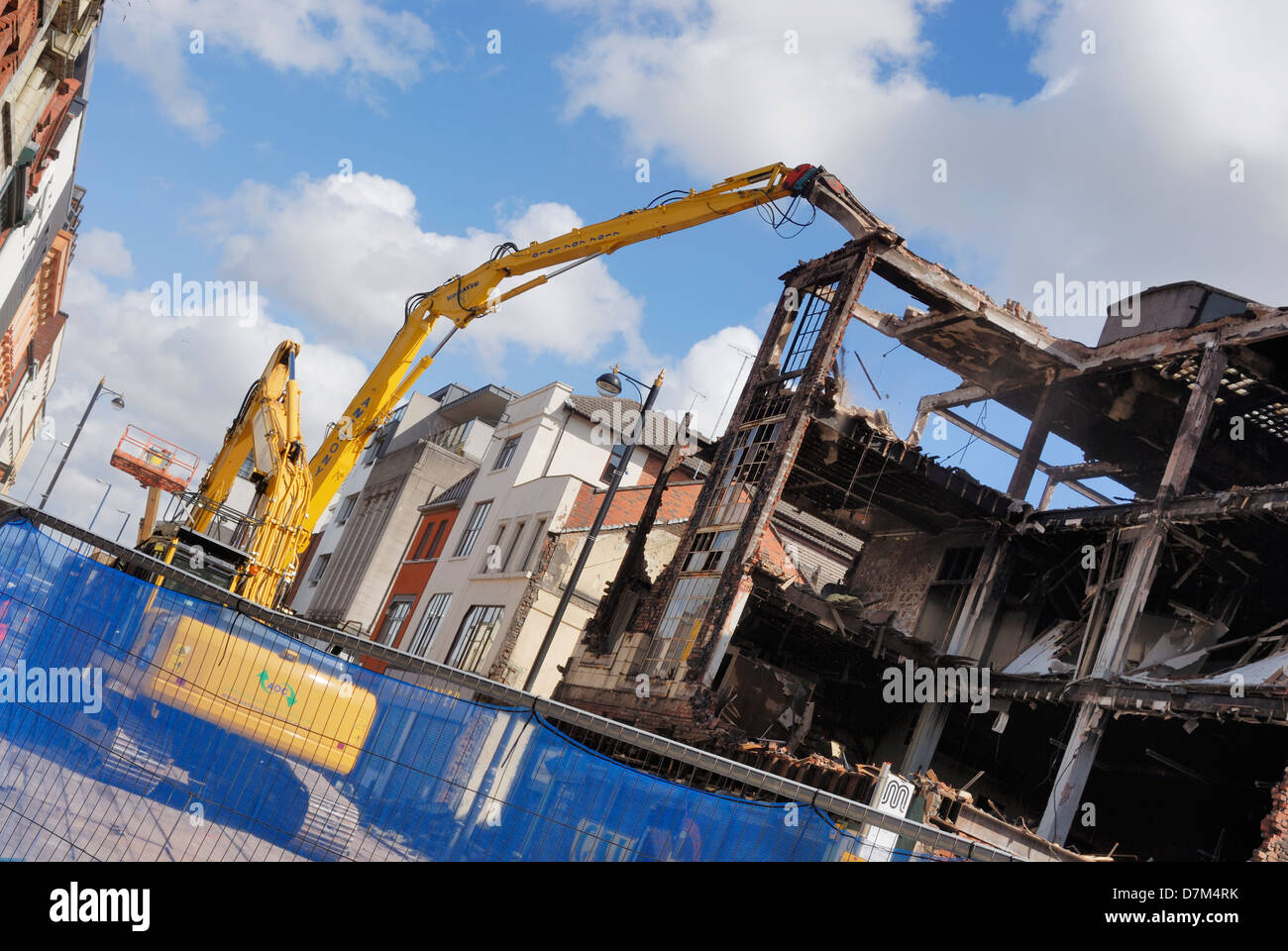 Demolition of a building damaged by fire in Oldham Street, Manchester. - Stock Image