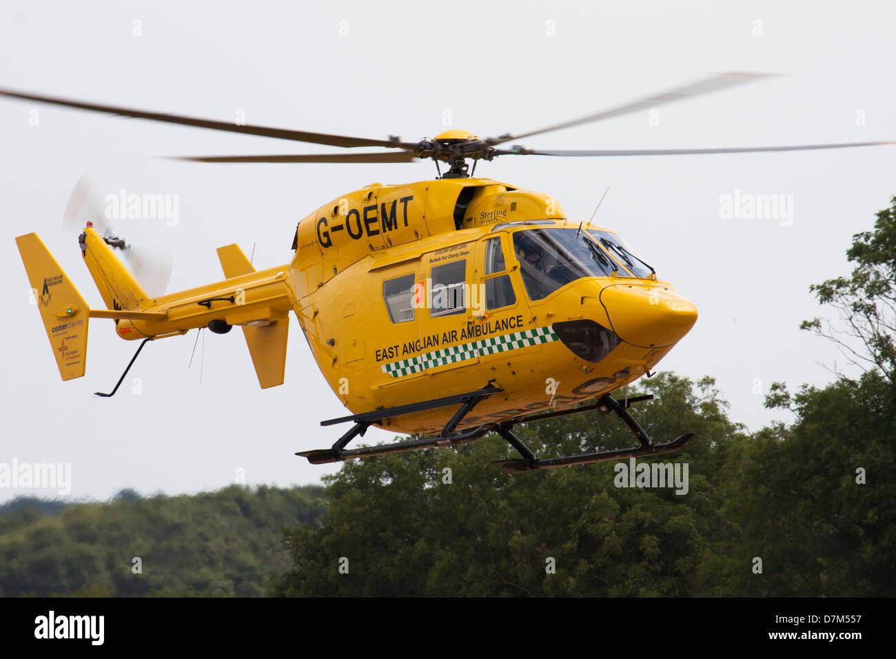 East Anglian Air Ambulance landing - Stock Image