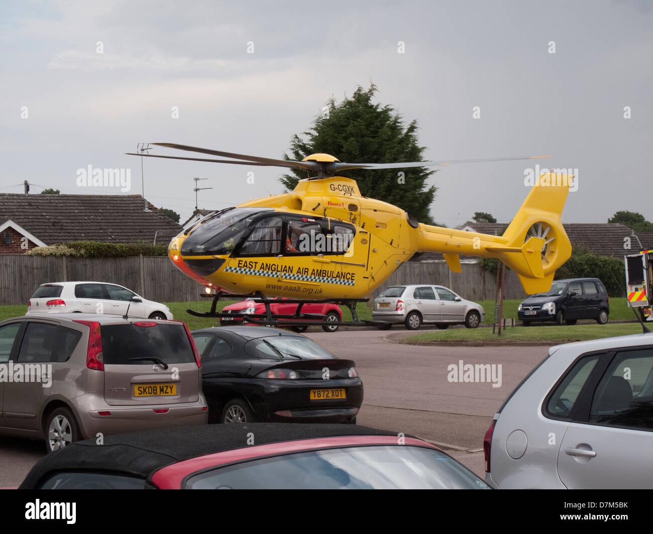 East Anglian Air Ambulance landing in car park in Aylsham Norfolk - Stock Image