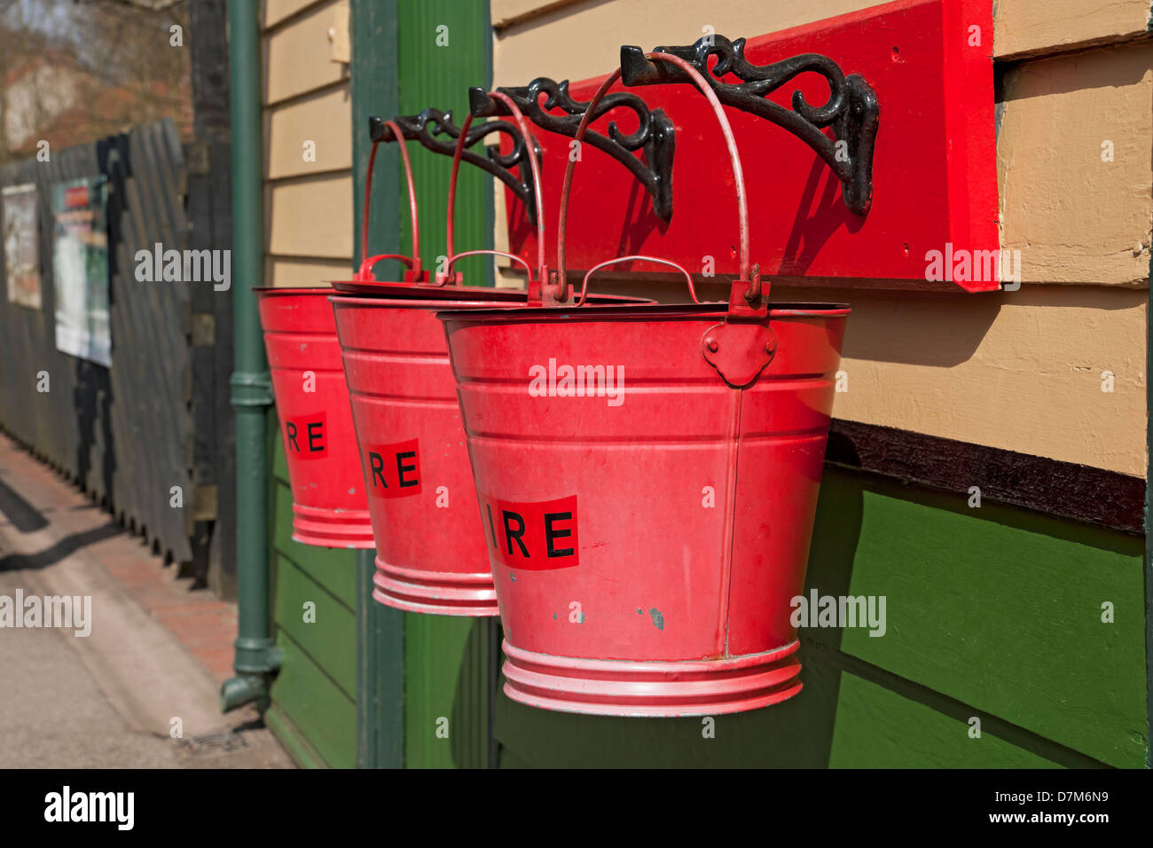 Close up of Three traditional red fire buckets bucket at Pickering Railway Train Station North Yorkshire England UK United Kingdom GB Great Britain Stock Photo