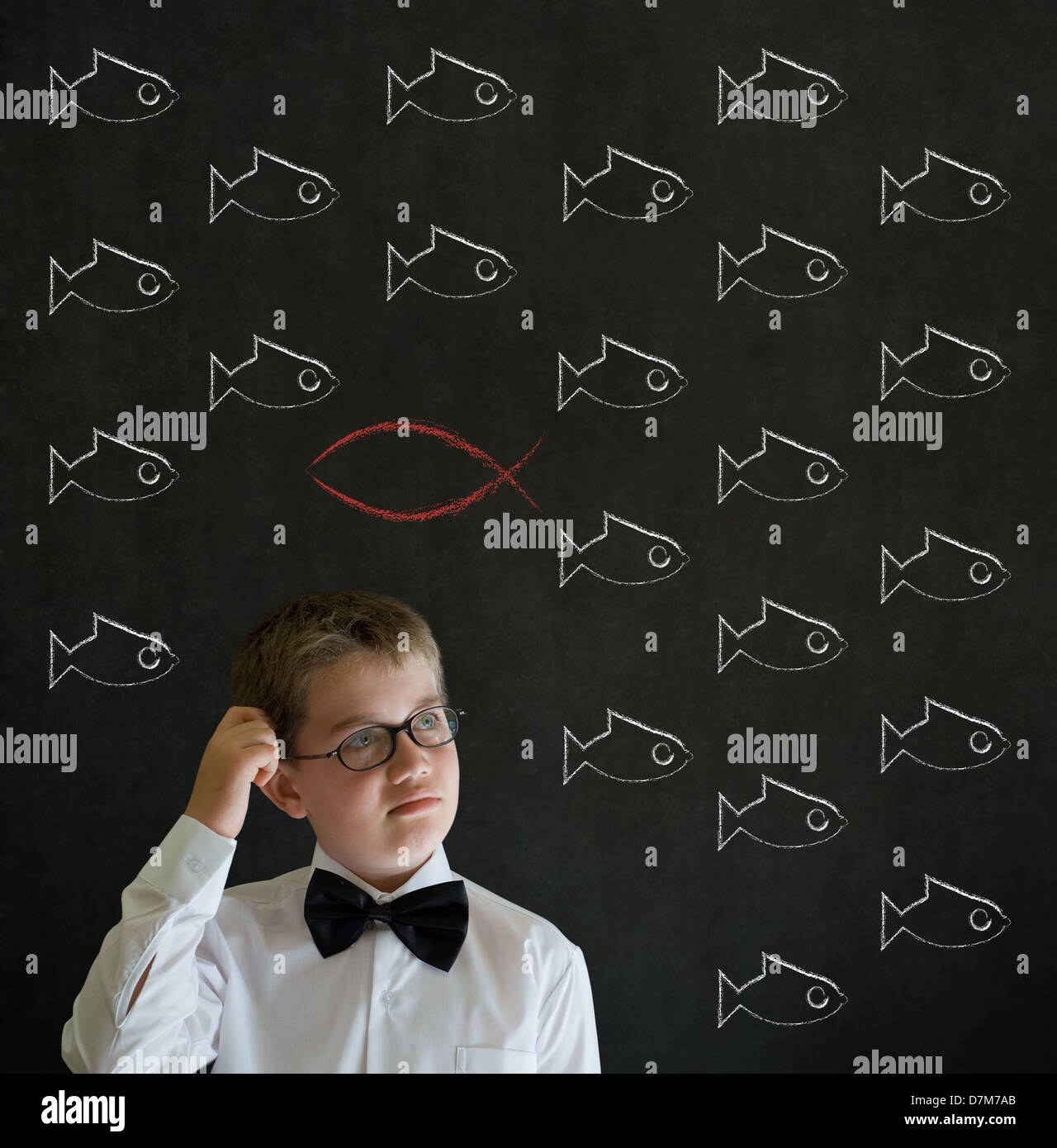 Scratching head thinking boy dressed up as business man with independent thinking Jesus, God, Christianity fish - Stock Image