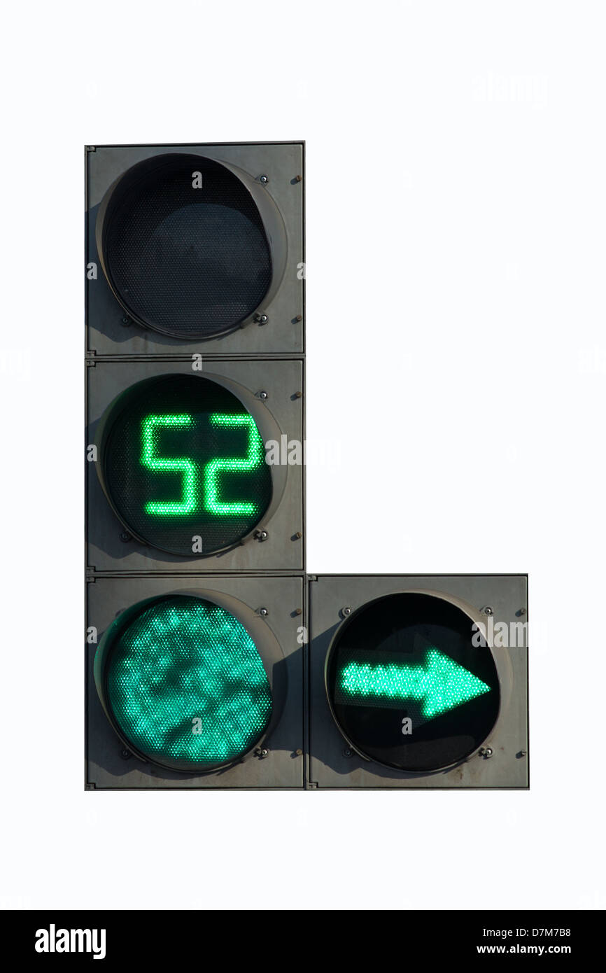 Green traffic light with green arrow and timer, isolated on white background - Stock Image