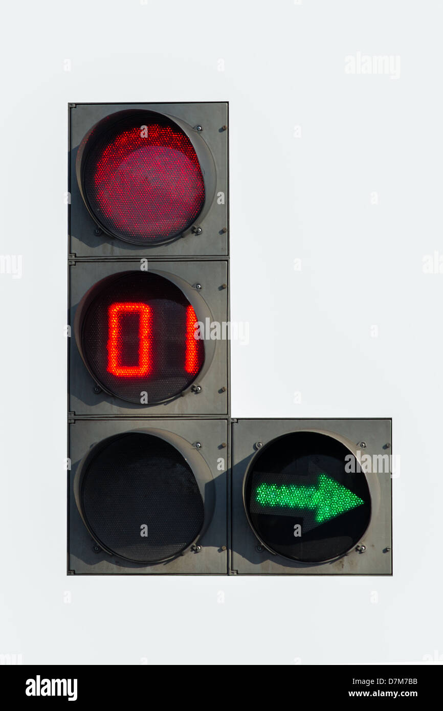 Red traffic light with green arrow and timer, isolated - Stock Image