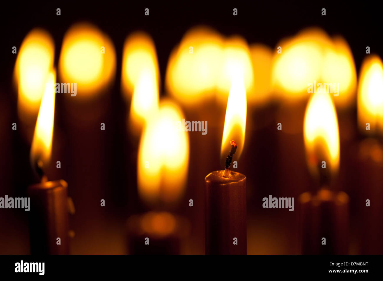 Lit candles - Stock Image