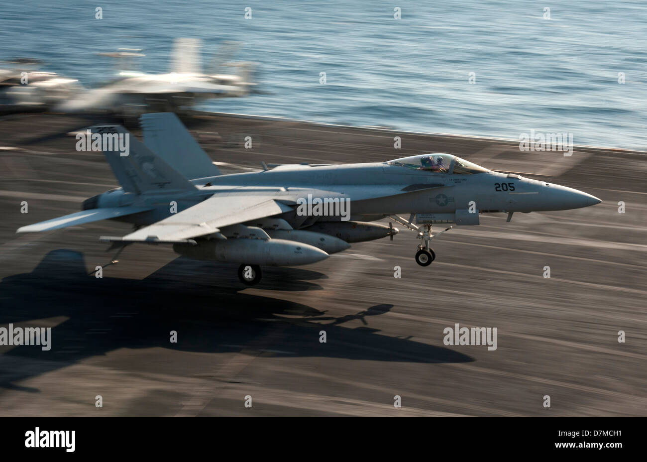 A US Navy F/A-18E Super Hornet lands on the flight deck of the aircraft carrier USS Nimitz May 8, 2013 underway Stock Photo